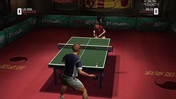 The player character competing against an opponent in a game of table tennis. The head-up display elements are visible on-screen.