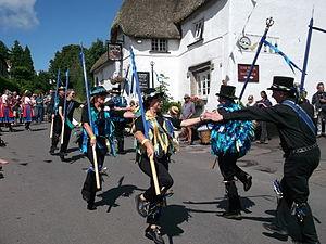 "Stave dancing - Stave dancing on Dartmoor, Devon. Bradninch Millers perform a Stourton Caundle dance ""Arches""."