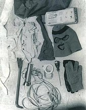 The murder kit includes a sports bag, garbage bags, ski mask, nylon stocking with holes, flashlight, crowbar, an ice pick, and some gloves.