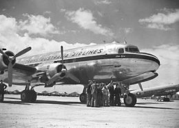 "Four-engined civil airliner on airfield, bearing the legend ""Trans Australia Airlines"""