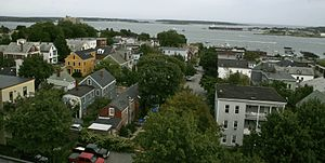 Munjoy Hill - Looking southeast down Waterville St. toward Casco Bay with Bug Light, and in the far right-hand corner Portland Head Light