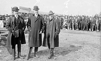 Charles Weeghman - Charlie Weeghman (left) at the groundbreaking ceremony for Weeghman Park, March 4, 1914. Note the shovels in the background.