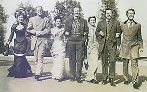 Another Part of the Forest (film) - Publicity still with, from left to right, Dona Drake, Dan Duryea, Ann Blyth, Fredric March, Florence Eldridge, Edmond O'Brien, and John Dall