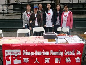 Chinese-American Planning Council - CPC volunteers tabling at an event to outreach to the community