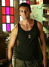 Zod in the TV program Smallville, wearing a black athletic shirt, camouflage pants and Kryptonian dog-tags