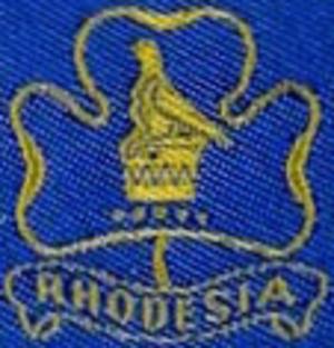 Girl Guides Association of Zimbabwe - The emblem of the previous Girl Guides Association of Rhodesia incorporated the Zimbabwe Bird.