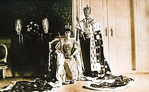 King Haakon VII and Queen Maud of Norway wearing their coronation crowns and robes in 1906.