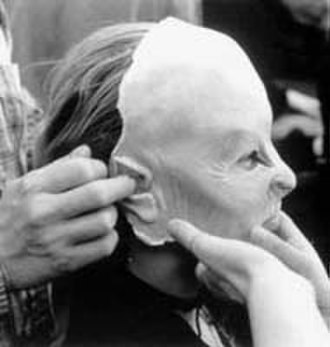 Ginger Snaps (film) - Katharine Isabelle having a facial prosthetic applied.