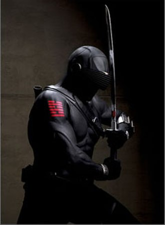 Snake Eyes (G.I. Joe) - Ray Park as Snake Eyes in G.I. Joe: The Rise of Cobra. Printed on his arm is the Ba gua trigram symbols for water and fire: the hexagram symbol for completion. The symbol is also used for the Arashikage Ninja Clan, of which Snake Eyes is a member.