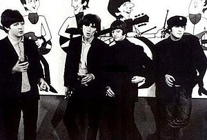 The Beatles (TV series) - The Beatles stand before cartoon images of themselves from the ABC TV series, 1965.