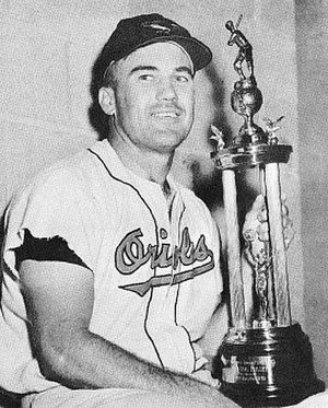 "Dave Philley - Dave Philley holds his Orioles' ""Most Valuable Player"" trophy, awarded in 1955 for leading the club in hitting with a .299 batting average"