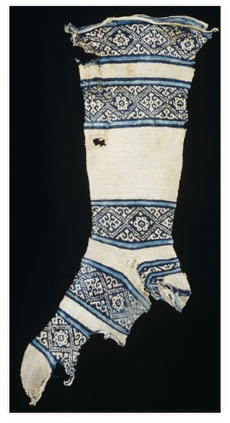 Sock - 12th-century cotton sock, found in Egypt. The knitter of this sock started work at the toe and then worked up towards the leg. The heel was made last and then attached to loops formed while knitting the leg. This practice allowed the heel to be easily replaced when it wore out.