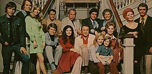 Return to Peyton Place (TV series) - Original cast. Front row on stairs, from left: Larry Casey, Julie Parrish, Warren Stevens, Kathy Glass, John Levin, Bettye Ackerman. Back row on stairs, from left: Stacy Harris, Frank Ferguson, Joe Gallison, Mary K. Wells. Standing right: Evelyn Scott and Guy Stockwell. Standing left: Ben Andrews, Ron Russell, and Pat Morrow.