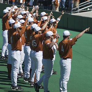 Texas Longhorns baseball - The Longhorn baseball team gives the Hook 'em Horns sign after a game.