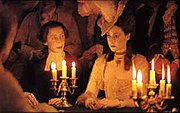 A candlelit scene with Reverend Runt and Lady Lyndon.
