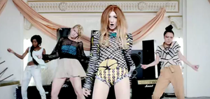 """Beat of My Drum - Roberts in the video for """"Beat of My Drum"""", wearing a 1970s inspired outfit. She performs with three female dancers throughout the video."""