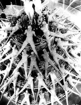 "Busby Berkeley - The ""By a Waterfall"" production number from Footlight Parade (1933) made use of one of the largest soundstages ever built, specially constructed by Warner Bros. to film Berkeley's creations."
