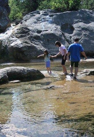 "Arbuckle Mountains - Visitors explore ""Devil's Bathtub"" at Falls Creek"