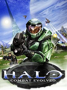 "Image of a soldier clad in futuristic green armor, pointing a black weapon towards the camera. Other soldiers and vehicles of war appear in the background. Below the green soldier is a decorative logotype with ""HALO"" and the subtitle ""Combat Evolved""."