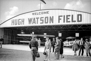 Cincinnati–Blue Ash Airport - By 1938, there were two Watson airports. Hugh Watson Field operated out of this hangar on Glendale–Milford Road, while Parks Watson Airport operated out of the original Grisard barn-turned-hangar just to the south.