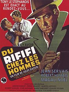 "Movie poster illustrates Tony le Stephanois wearing a green jacket over a red background. In the background Jo le Suédois attempts to pull a telephone away from his wife. Text at the top of the image includes the tagline ""Tony le Stephanois et exact au rendez-vous"". Text at the bottom of the poster reveals the original title and production credits."