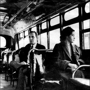Rosa Parks - Parks on a Montgomery bus on December 21, 1956, the day Montgomery's public transportation system was legally integrated. Behind Parks is Nicholas C. Chriss, a UPI reporter covering the event.