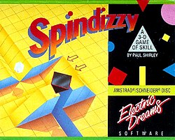 "Artwork of a horizontal rectangular box. The top portion reads ""Spindizzy"". The left half depicts a yellow grid, and the right half displays advertising and publisher information against a black backdrop."