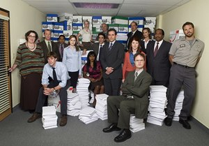 The Office (U.S. TV series) - The Office cast in the third season, from left to right: saleswoman Phyllis Lapin (Phyllis Smith), human resources Toby Flenderson (Paul Lieberstein), salesman Jim Halpert (John Krasinski, seated), accountant Oscar Martinez (Oscar Nunez), receptionist Pam Beesly (Jenna Fischer), accountant Angela Martin (Angela Kinsey), customer services representative Kelly Kapoor (Mindy Kaling), temp worker Ryan Howard (B. J. Novak), quality assurance representative Creed Bratton (Creed Bratton, in back), regional manager Michael Scott (Steve Carell), supply relations representative Meredith Palmer (Kate Flannery), salesman Dwight Schrute (Rainn Wilson, seated), accountant Kevin Malone (Brian Baumgartner), Vice President for Regional Sales Jan Levinson (Melora Hardin), salesman Stanley Hudson (Leslie David Baker), and warehouse worker Roy Anderson (David Denman).