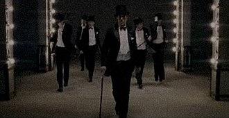 """Black and Gold - Sam Sparro dancing with his look-a-likes, from the second music video for """"Black and Gold""""."""