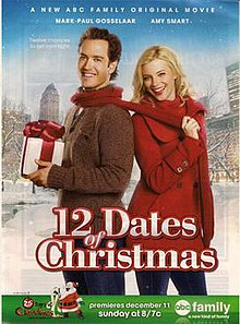 Miles (Mark-Paul Gosselaar) and Kate (Amy Smart) standing outside in winter; Miles is holding a wrapped present