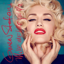 A photograph displaying Gwen Stefani wearing a navy top whilst her hands touch her face. The title of the song is shown in a red, cursive script.