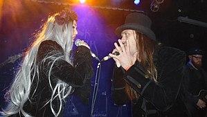 "Dark Sarah - Heidi Parviainen and Juha-Pekka Leppäluoto singing live as the characters ""Dark Sarah"" and ""The Dragon"" at a concert in November 2017"
