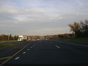 Illinois Route 120 - Eastbound IL 120 approaching Hunt Club Road on divided highway section.