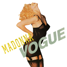 "A blond woman poses with her head leaning back, wearing a black corset. Alongside her, the word ""Madonna"" is written in yellow capital letters, and just underneath this, to its side, ""Vogue"" is also written in bigger, grey capital letters."