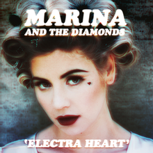 "A close-up of a light-skinned blonde-haired woman with a small heart symbol located next to her left eye. The name ""Marina and the Diamonds"" is located above her picture, while the title ""Electra Heart"" is placed beneath her chin."