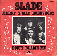 "A monochrome photograph of Slade, with a white border, set almost centrally in a red square. The words ""SLADE"" dominate the cover, underneath which is written ""MERRY X'MAS EVERYBODY"". Underneath the photograph are the words ""DONT BLAME ME"". White stars border the left and right sides of the photograph."