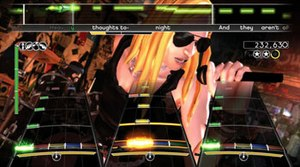 "Rock Band - A screenshot of a full band playing Metallica's ""Enter Sandman"" in Rock Band: each instrument is represented by a different interface: lead guitar (left), drums (middle), bass guitar (right), vocals (top)."