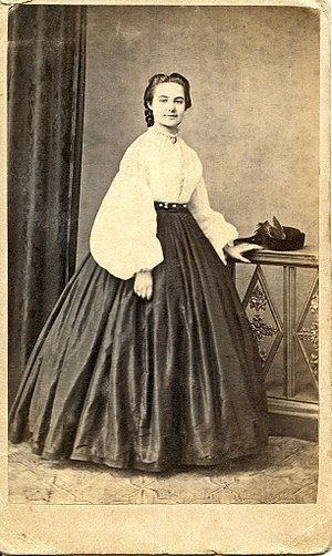 Garibaldi shirt - In 1860, the Empress Eugénie de Montijo, of France, introduced the Garibaldi blouse, as popular women's fashion. Woman in white, Garibaldi blouse,  photograph, circa 1860-1865.