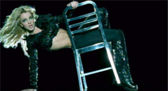 """Stronger (Britney Spears song) - Spears in the video for """"Stronger"""". Wearing a futuristic outfit, she performs while dancing with a chair throughout the video."""