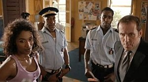 Death in Paradise (TV series) - The original team: Left-to-right: Sara Martins, Danny John-Jules, Gary Carr and Ben Miller