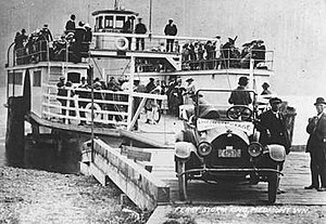 Ferries and steamboats of Lake Crescent, Washington - Ferry Storm King disembarking passengers at Piedmont on Lake Crescent