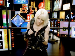 "Jump (Madonna song) - Madonna sporting a blond bob wig and a leather ensemble, in the music video of ""Jump""."