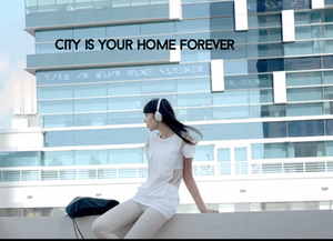 """Adventure (Madeon album) - A screenshot from Madeon's music video for """"You're On"""". The centered person is Asteria. On the building in the back, a code written in the typical Madeon alphabet is visible (in addition to its translation)."""