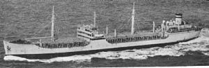 USNS Mission San Rafael (T-AO-130) underway with a deck cargo of oil drums, date and location unknown.