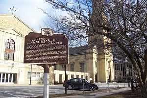 Joshua Glover - Wisconsin Historical Marker identifying the site of the original court house and jail where Joshua Glover was rescued by a mob of 5,000 people,  in Milwaukee, Wisconsin.
