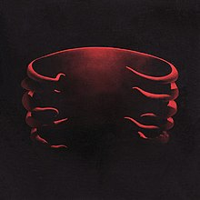 Cover art for Undertow featuring a red 3D model of a ribcage designed by Adam Jones