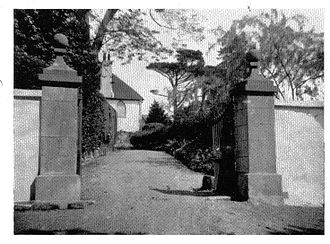 Woodway House - A view of the driveway with its granite gateposts and the cast-iron gates which somehow survived World War II.