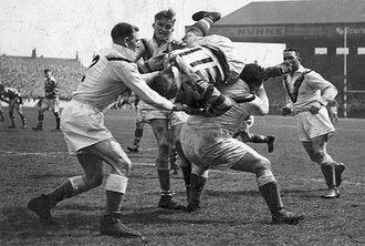 Frank Whitcombe - Image: Bradford Northern's Frank Whitcombe tackles Warrington's Jim Featherstone