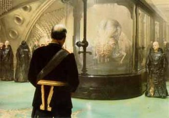 Spacing Guild - Mutated Guild Navigator suspended in a tank filled with spice gas, accompanied by Guild agents, from the David Lynch film Dune (1984).