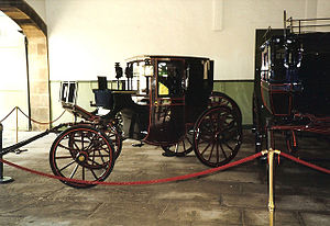 Royal Mews - A Royal Mews Brougham on display alongside a Station Bus at Holyrood Palace in Edinburgh.